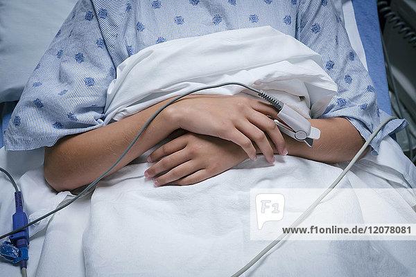 Monitor on finger of Caucasian girl in hospital