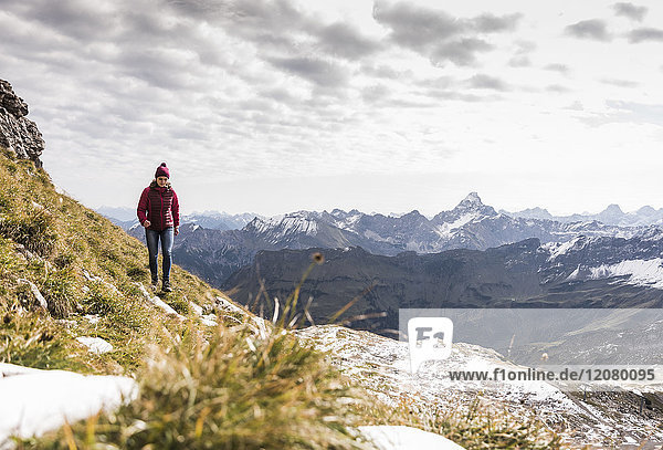 Germany  Bavaria  Oberstdorf  hiker walking in alpine scenery
