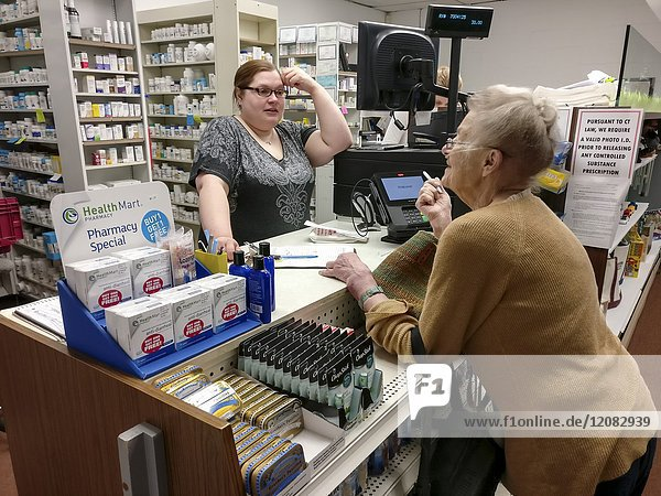 SHARON CONNECTICUT USA Elderly woman visits the pharmacy.