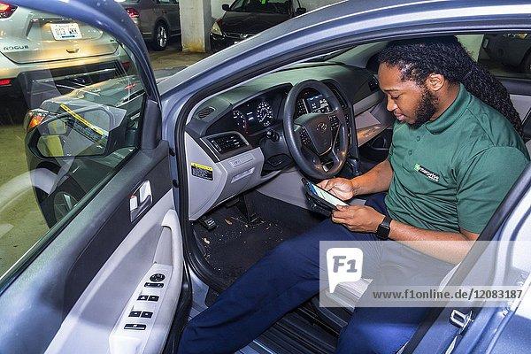 Washington DC  District of Columbia  Enterprise Rent-A-Car  car rental company  Black  man  return agent  inspecting car  employee  checking