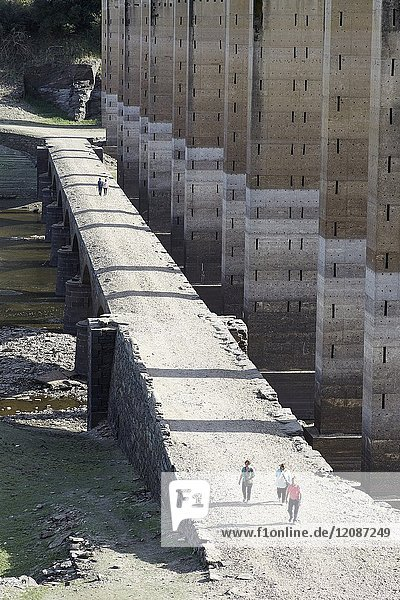 Severe drought suffered by the Peninsular Northwest. Image of bridges  one old and one modern  in the Portomarin reservoir  Lugo Bathed by the Miño River. The water level  It is very low letting see old buildings. Galicia  Spain.