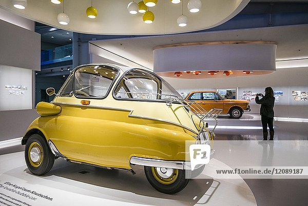 Germany,  Bavaria,  Munich,  BMW Museum,  1955 BMW Isetta bubble car with photographer,  MR-GER-17-001.
