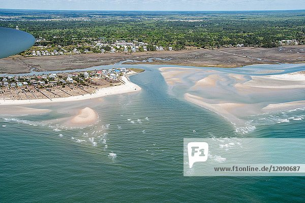 Sand bars linger on surface of ocean waters by stately beach homes on Myrtle Beach  South Carolina.