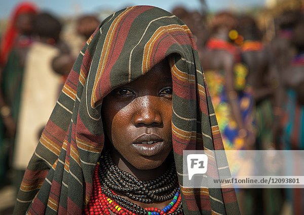 Young woman during the proud ox ceremony in Dassanech tribe  Turkana County  Omorate  Ethiopia.