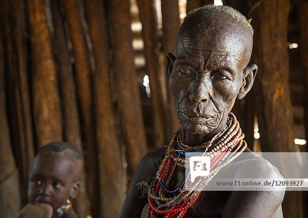 Mrs Moko who had to kill ten children she had before her wedding and who were mingis  Omo valley  Korcho  Ethiopia.