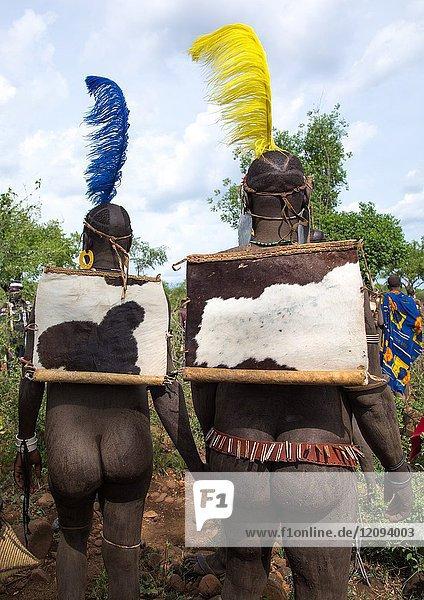 Rear view of Bodi tribe fat men during Kael ceremony  Omo valley  Hana Mursi  Ethiopia.