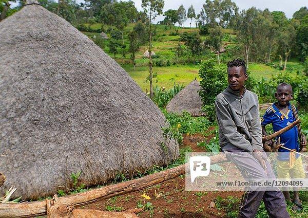 Boys sit near their traditional house  Gamo Gofa Zone  Ganta  Ethiopia.