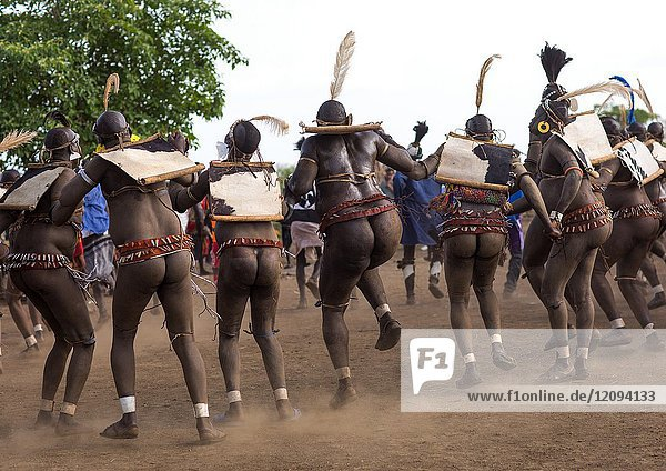 Bodi tribe fat men dancing during Kael ceremony  Omo valley  Hana Mursi  Ethiopia.