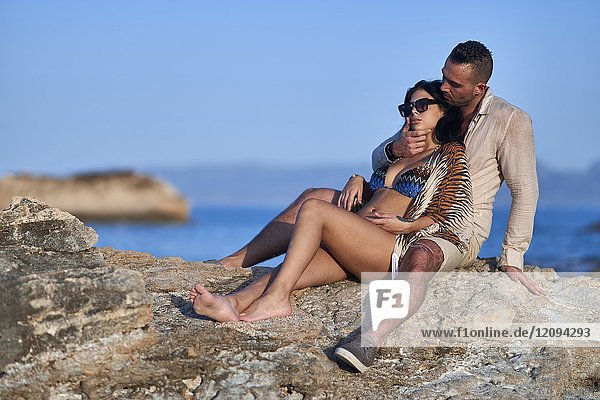 Young couple together at Mediterranean beach. Greek ethnicity. In holiday destination Hersonissos  Crete  Greece