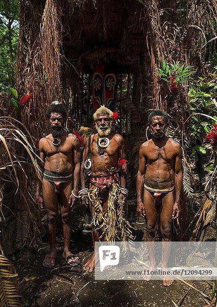 Portrait of chieftain Etul and his sons in front of the nakamal  Ambrym island  Fanla  Vanuatu.