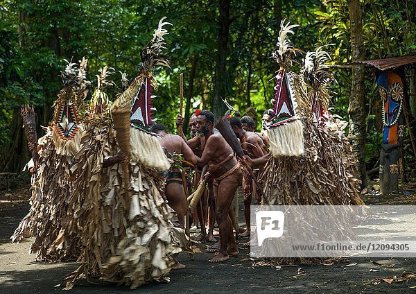 Rom dance masks and giant slit drum during a ceremony  Ambrym island  Fanla  Vanuatu.