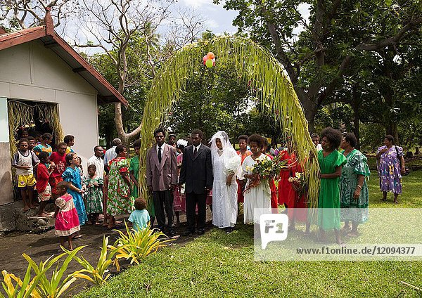 Bride and groom entering the church during a traditional wedding  Malampa Province  Ambrym island  Vanuatu.