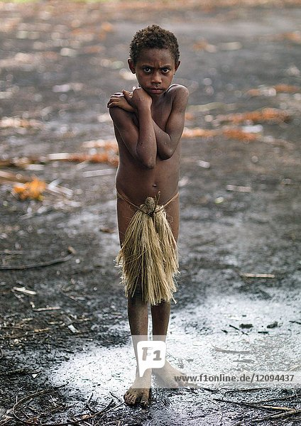 Boy wearing a penis sheath called a namba suffering from the cold  Tanna island  Yakel  Vanuatu.