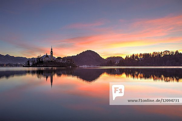 Lake Bled and the small island in the middle at sunrise  Bled  Slovenia.