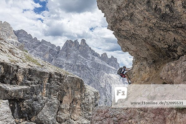 Climber on the via ferrata Cengia Gabriella  Popera group  Giralba  Sexten Dolomites  Belluno  Veneto  Italy.