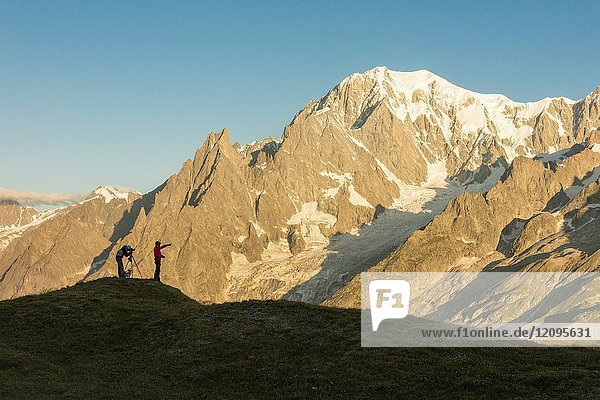 Photographers admire the Mont Blanc massif at dawn Graian Alps Courmayeur Aosta Valley Italy Europe.