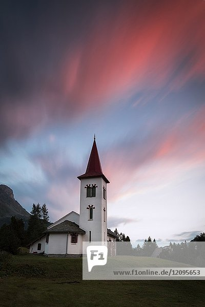 Pink clouds at sunset on Chiesa Bianca  Maloja  Bregaglia Valley  Canton of Graubünden  Engadin  Switzerland.