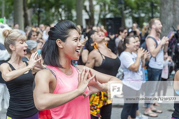 Exercisers participate in a Garjana dance workout in Washington Square Park in New York on Thursday  September 14  2017. The workout celebrated the ending of the Food Tank Summit which approached the problems of global food waste. Garjana uses 'Bollywood' style dance moves in their workout. (© Richard B. Levine).