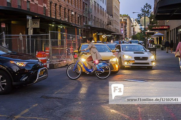 A woman rides her CitiBike through traffic in the Meatpacking district in New York on Saturday  September 9  2017. (© Richard B. Levine).