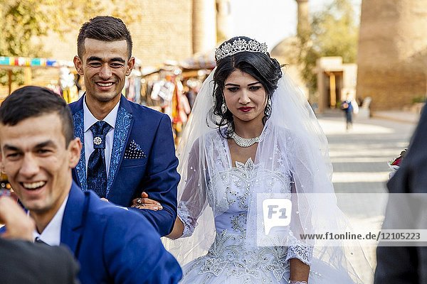A Young Uzbek Couple Walk Through The Streets Of Khiva After Getting Married  Khiva  Uzbekistan.