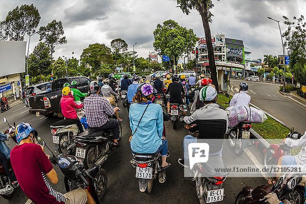 Two-wheeled traffic in Ho Chi Minh City (Saigon)  Vietnam. There are over four million motorbikes in the city.
