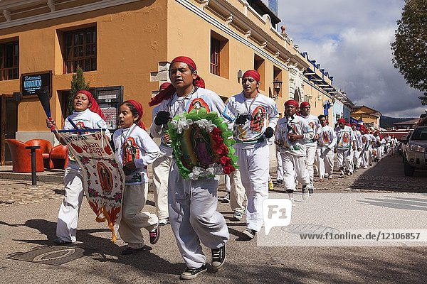 Pilgrims running in the street at the city centre during the celebration of the feast of Virgen de Guadalupe  San Cristobal De Las Casas  Chiapas Region  Mexico  Central America