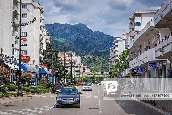 Street in Bar coastal town in southern Montenegro. Rumija mountain range on background.
