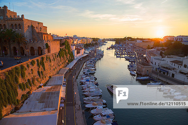 View of historic harbour waterfront and town hall at sunset  Ciutadella  Menorca  Balearic Islands  Spain