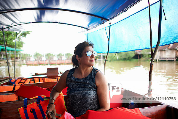 Woman wearing sunglasses on ferry looking away  Bangkok  Krung Thep  Thailand  Asia