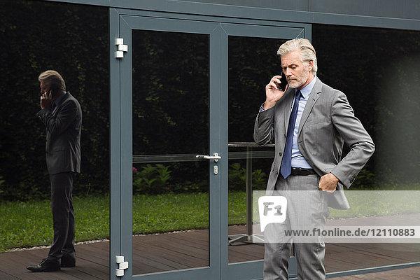 Businessman making telephone conversation on smartphone