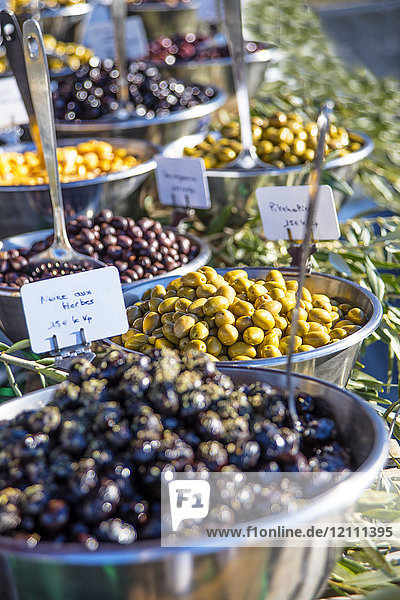Different varieties of olives on a stall at the market