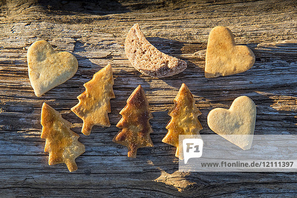 Christmas biscuits on a tree trunk