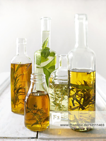 Assortment of diffrent flavored herb oils