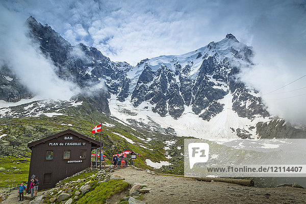 The chalet at Plan de l'Aiguille and Aiguille du Midi summit in the fog; Chamonix-Mont-Blanc  Haute-Savoie  France