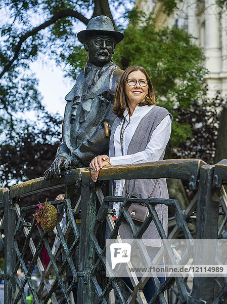 A woman stands beside the Monument of Imre Nagy in Martyr's Square; Budapest  Budapest  Hungary