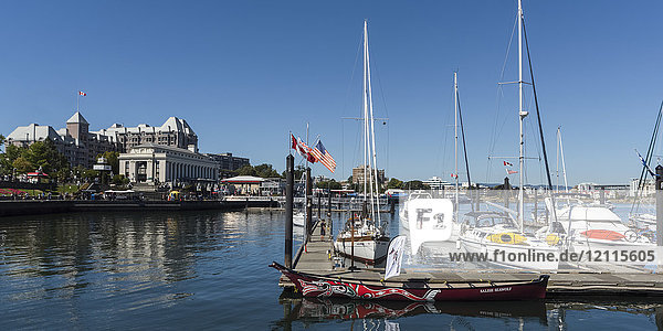 Boats docked in the tranquil Inner Harbour of Victoria  Vancouver Island; Victoria  British Columbia  Canada