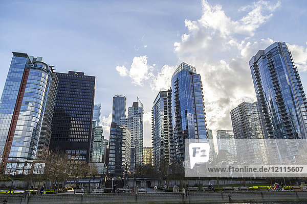 Vancouver city skyline from the coal harbour waterfront  looking up towards the luxury real estate condos and hotels; Vancouver  British Columbia  Canada