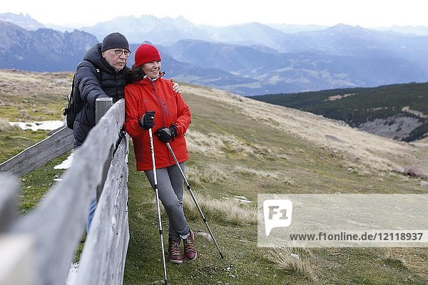 Man and woman  couple during Nordic Walking in the mountains  Rittner Horn  South Tyrol  Italy  Europe