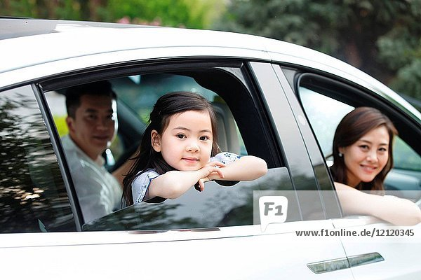 Happy families travel by car
