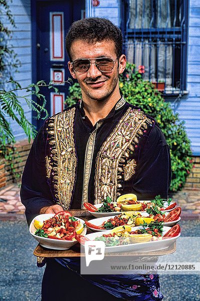 Local man with colorful food in Istanbul Turkey