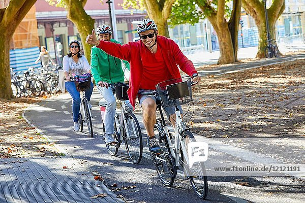 Group of tourists and guide making a bicycle tour through the city  Donostia  San Sebastian  Gipuzkoa  Basque Country  Spain  Europe