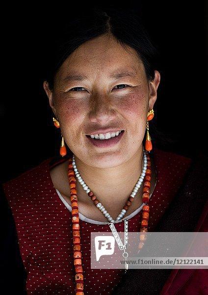 Portrait of a tibetan nomad woman  Qinghai province  Tsekhog  China.