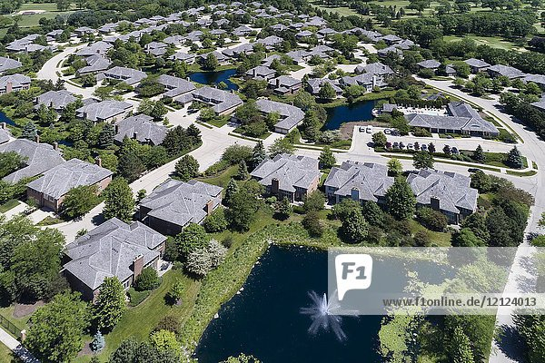 Aerial view of a luxury townhouse complex with ponds in the Chicago suburban neighborhood of Northbrook  IL in summer. USA.
