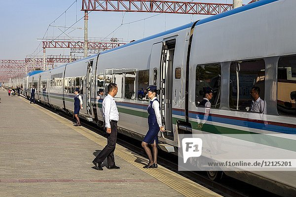 Female Ticket Inspectors Standing Outside The Afrosiyob High Speed Train  Bukhara Railway Station  Bukhara  Uzbekistan.