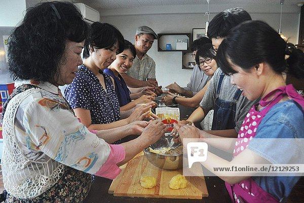 Naha  Okinawa  Japan: Japanese people making fresh pasta during an Italian cooking class