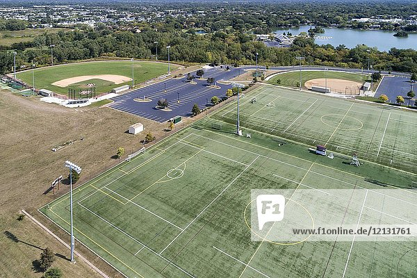 Aerial view of a high school playfield with baseball diamonds and a football field in Glenview  IL. USA.