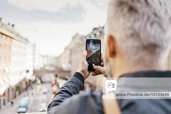 Man taking photograph of street in Stockholm  Sweden