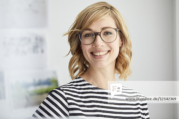 Portrait of smiling blond woman  glasses