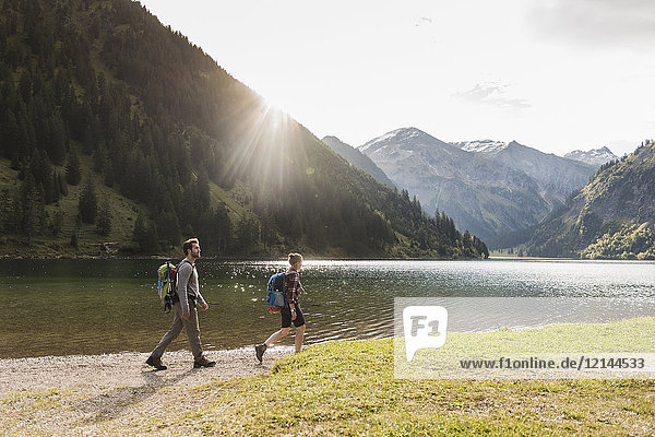 Austria  Tyrol  young couple hiking at mountain lake