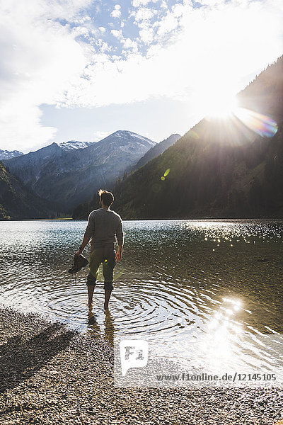 Austria  Tyrol  hiker refreshing in mountain lake